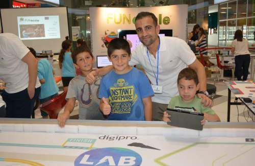 Stelios posing with young friends trying out BB8-droid and SPRK!